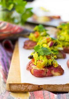 Smashed Potatoes with Loaded Guacamole.  These little delicious appetizers are so easy to make and everyone is sure to love them! {vegan, gluten free}