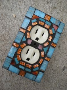 outlet cover... oh how happy this would make me!  One in shades of honey for the kitchen (a bee would be a plus)....