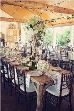 Towering floral centerpieces for this beautiful rustic reception #wedding #rustic #chic #tablescape #centerpiece