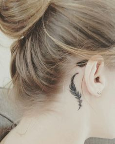 Small feather tattoo behind the ear. My latest edition. #BehindTheEarTattooIdeas