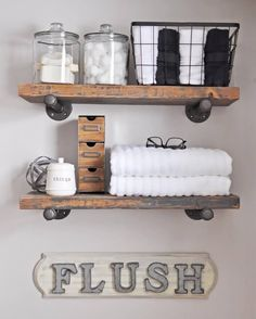 Beautiful wooden shelves supported by industrial pipes
