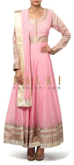 Buy Online from the link below. We ship worldwide (Free Shipping over US$100). Product SKU - 310912.Product Link - http://www.kalkifashion.com/pink-anarkali-suit-adorn-in-sequin-and-zari-embroidery-only-on-kalki-19027.html