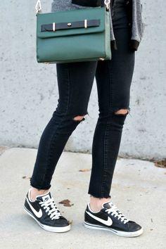 Classic Nikes, distressed denim skinny jean, green cross body bag. Casual fall style