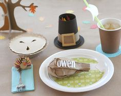 If there's going to be a kids' table, we might as well make it fun for them! Use a brown paper bag and some white paper to create clever turkey leg place settings, black paper cups easily transform into pilgrim hat crayon holders, and clothes pins and colored paper magically turn into fun turkey clips for your kids' utensils.
