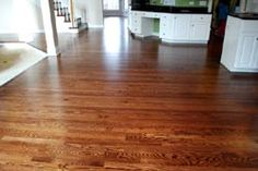 The red oak floors were stained rosewood and our favorite finish system – Pall-X 96 – was used with a satin sheen. Refinishing Hardwood Floors, Oak Hardwood Flooring, Floor Refinishing, Oak Floor Stains, Russell House, Wood Floor Stain Colors, Red Oak Floors, Oak Color, Trends