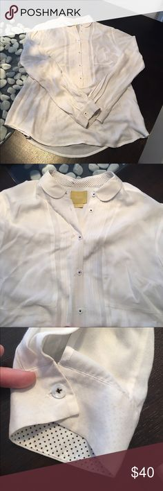 Maeve White Tailored Button Down Blouse Size 8 VGUC. No discoloration or flaws in this shirt. Material is 100% rayon and is this very soft and light. Buttons are pearly white and inside of sleeves and collar is a small black polkadot pattern. Size 8. Will post measurements if needed. Any further questions or clarifications, please don't hesitate to ask. Anthropologie Tops Blouses