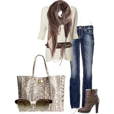 Love this. Neutral sparkling purse with a neutral long top paired with a belt on the hip and scarf to match. Great!