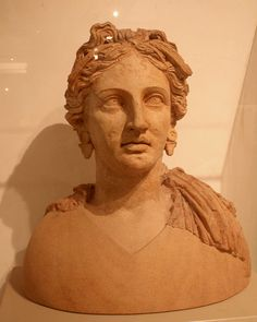 Bust of Kore wearing a cloak, circlet, and earrings. Terracotta. End of the 4th/first half of the 3rd c. BCE Votive deposit of the sanctuary of Demeter and Kore at loc. Casaletto, Ariccia.  Museo Nazionale Romano: Terme di Diocleziano Rome, Italy