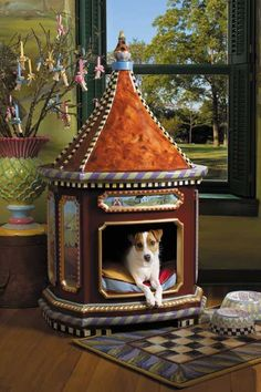 I am not really into dog houses, but this one, by MacKenzie-Childs, would be very welcome in my home (even without a dog in it...). Can't you just see a toddler using it as a secret hideaway?