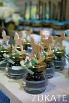 Rocking horse favors at a baby toys baptism party! See more party planning ideas at CatchMyParty.com!