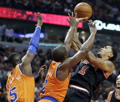 Chicago Bulls guard Derrick Rose (1) shoots over New York Knicks guard Raymond Felton (2) and guard Tim Hardaway Jr during the second half of an NBA basketball game in Chicago, Thursday, Oct. 31, 2013. The Bulls won 82-81. (AP Photo/Nam Y. Huh)