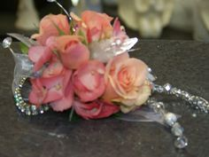 Perfectly Peach!   Elise spray roses with gleaming leaves, crystals and dangling beads.  Designed by Lorraine. Style number S-17