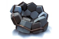 Quartz is an armchair designed by CTRL ZAK and Davide Barzaghi, the result of a mathematical series applied to furnishings. The two-dimensional structure in beechwood – pentagons and hexagons – develops three-dimensionally in space thanks to the volumising effect of the stuffing, upholstered with natural fibres.