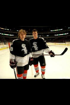 They both look young and very cute in this picture wearing the Chicago White Sox jerseys. :)
