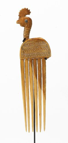 Africa | Comb from the Baule people of the Ivory Coast | Elephant ivory with lead inlaid eye