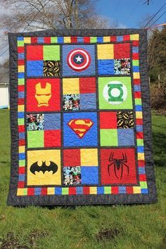 Puddle Jumper Quilts 'n' things: SuperHero Baby Quilt. Amazing applique logos and great idea for the quilting!
