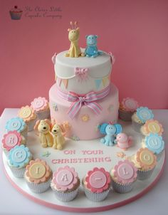 Christening cake with various animals and matching cupcakes