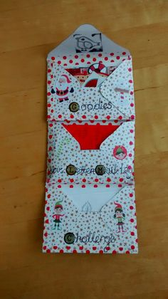 Here's a Christmas envelope flipbook that I made. It was fun trying to make an envelope flipbook since I'd never made one before. There's lots of Christmas themed goodies in here which were fun to put together.