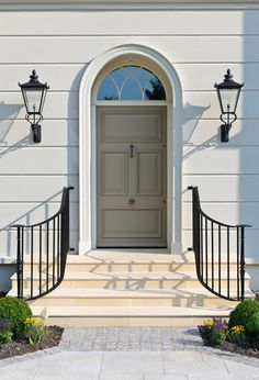 Everything about this is perfect.  The siding, the moulding, the door design, lanterns, curve of the railings, etc.