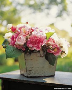Love the vintage container for the arrangement - use smaller water-filled jars inside if container isn't watertight