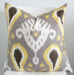 Totally making my own covers with this fabric.   Decorative pillow cover - Throw pillow - Ikat pillow 20x20 - Batavia ikat - Gray - Yellow - Brown - White - Designer fabric