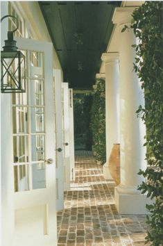 We love the columned walkway that wraps around this home. Add climbing ivy for more privacy and outdoor furniture to host cocktail parties.