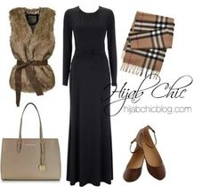 Fur gilet adds oomph to a plain black maxi