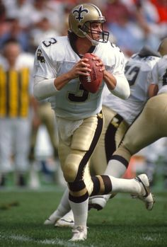 Bobby Hebert of the New Orleans Saints drops back to pass against the Los Angeles Rams during an NFL Football game November 13 1988 at Anaheim...
