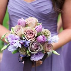 The girls carried lavender tulips, roses and sweet peas. Would look good with wisteria