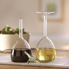 Wine Glass Oil & Vinegar Set. They look like they're upside down! These would look so cool on the kitchen counter.