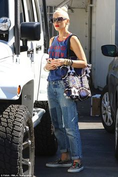Just a glimpse! The 47-year-old pop singer wore a cheerful top reading: 'Good Vibes Only' ...