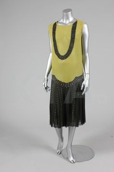 Chartreuse and black chiffon dress with rhinestone embellishment, late 1920's.