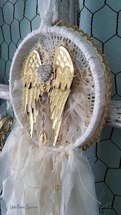 Petite Golden Wings This gorgeous dream catcher is my shabby chic version, but tattered and torn for more romantic vintage charm! Everything has been hand stitched together piece by piece, layer upon layer down to every tiny button, all lovingly stitched with vintage cream