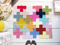 arrange any solid-color granny square in a cross formation. Love it!