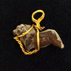 A rare middle Assyrian Bull Pendant, 16th to 10th centuries BC