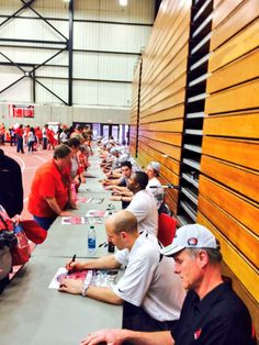 UCM Boys Basketball signing autographs after the pep rally celebrating their National Championship victory!