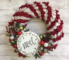 Approximately 18 in diameter. The burlap pieces were individually cut, folded then attached to a sturdy straw wreath form with Floral pins and secured with hot glue. The Noel wooden sign is hand painted and the wreath is adorned with balls, baubles, snowflakes and decorative holly berries.