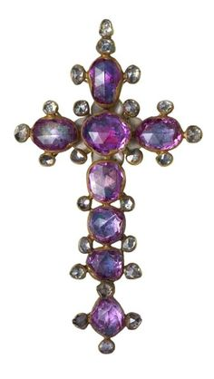 A gold and enamel pendant in the form of a Latin cross set with rose-cut pink sapphires and diamonds. The reverse is enamelled. Part of the Cheapside Hoard, late 16th-early 17th century.