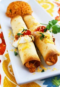 Baked Chicken Taquitos  Perfect use for rotisserie chicken (one of my fav foods). You can customize these to your taste by adding ingredients like black beans, different cheeses, ground beef instead of chicken...just use what you have on hand.