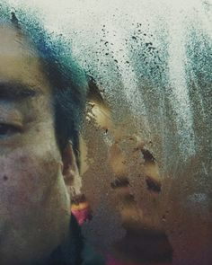 Michael Wolf Tokyo Compression'. His portraits are of commuters travelling on the Tokyo subway, crammed behind glass and steel whilst pressed uncomfortably against fellow travellers.