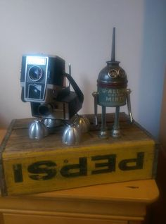 Finished Tinbots. MAde from vintage camera and vintage tins.