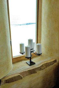 Straw bale walls offer deep windowsills reminiscent of European homes.