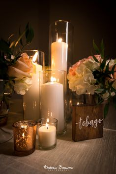 Candle light makes everything better. These low centerpieces mixed with candles. Candle light makes everything better. These low centerpieces mixed with candles and wooden details with a personal touch. Peonies Wedding Centerpieces, Candle Centerpieces, Wedding Reception Decorations, Wedding Flowers, Candles, Flowerless Centerpieces, Ghanian Wedding, Trinidad, Multicultural Wedding