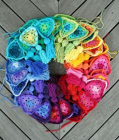 Crochet colour wheel by Rettgrayson via Flickr (a custom order of granny bunting, waiting to be joined together)  rettg.blogspot.com/2010/11/sigh.html