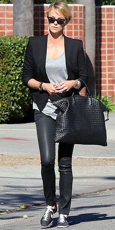 Charlize Theron, nailing the classic chic thing with a Bottega Veneta bag.