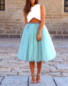 Tulle skirt and white crop top.