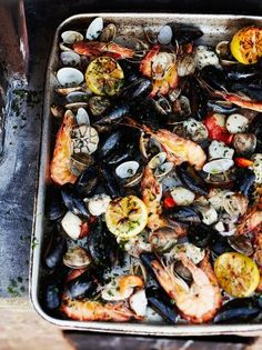 This Wood-fired shellfish dish is one of Jamie's favourite shellfish recipes accompanied by a lemon and garlic dressing and flat bread to mop up the sauce! Fish Dishes, Seafood Dishes, Fish And Seafood, Seafood Bbq, Seafood Platter, Shellfish Recipes, Seafood Recipes, Oven Recipes, Cooking Recipes
