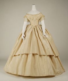 Wedding Dress  Date: 1858–59 Culture: American Medium: silk Dimensions: Length at CB: 13 7/8 in. (35.2 cm)