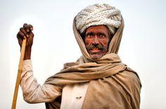 https://flic.kr/p/dQDWmp | Bikaner Herder | Camel herder against the hazy morning sky. Rajasthan, India.