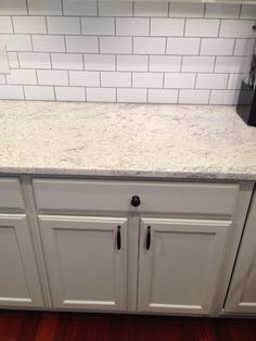 Abby M. Interiors: Thornapple kitchen: before and after but with black uba countertops